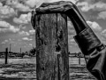 USA. Allensworth, California. 2014. Fence post. Allensworth has a population of 471 and 54% live below the poverty level.